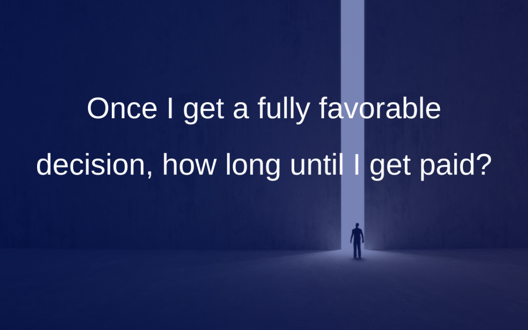 Once I get a fully favorable decision, how long until I get paid?